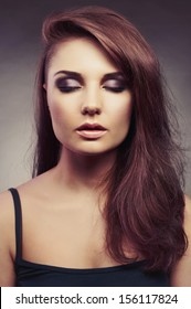 Fashion photo of young beautiful brunette lady