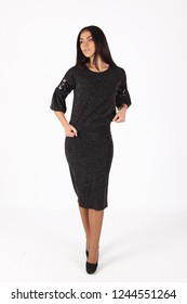 Fashion photo of young beautiful female model in  dress. Studio photo