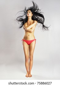 Fashion photo of young beautiful woman with magnificent hair