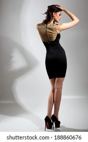 Fashion photo of young magnificent woman.Full length of beautiful female posing in studio.