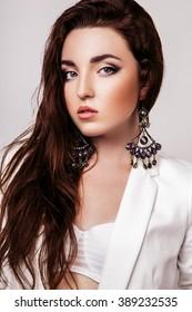 Fashion photo of young model woman on white background. Girl posing. Studio photo.