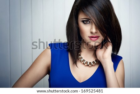 fashion picture of beautiful brunette woman with necklace