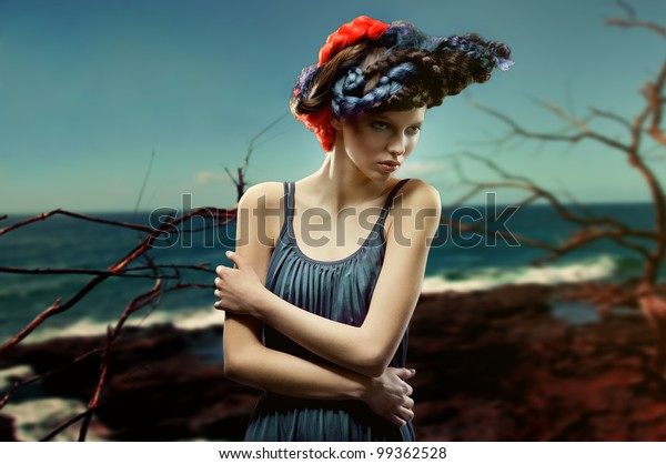 fashion picture of young woman with creative and colorful hairstyle