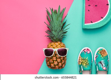 Fashion Pineapple in Sunglasses. Beach Summer Accessories.Flat lay. Creative Art concept. Tropical fruit, Stylish Hipster Outfit. Minimal. Party fashionable summertime Mood on Pink