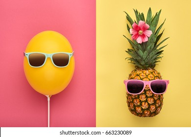Fashion Pineapple and Yellow air Balloon. Bright Summer Color. Tropical Hipster Fruit, Sunglasses. Creative Art concept. Minimal style. Hot Beach Vibes. Fun Party Mood