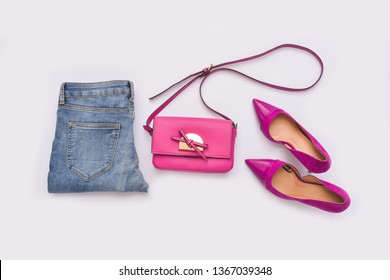 fashion pink handbag with pink shoes isolated on white background
