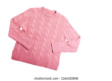 Fashion Pink knitted Sweater on white Background top view flat lay. Isolated. Fashion Clothes Trendy Cozy Knit Jumper Autumn or winter accessories. Natural Wool Sweater with a pattern. Female Fashion