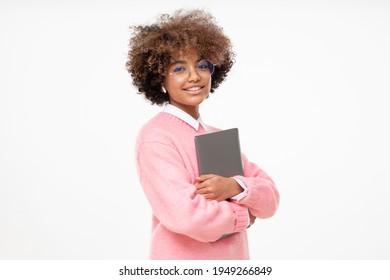 Fashion portrait of african american teen girl, college or online course student holding laptop, isolated on gray background