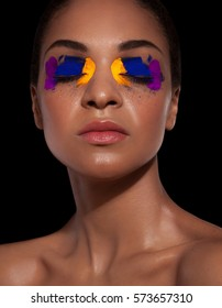 Fashion portrait african woman with color shadow
