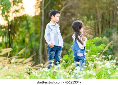 Fashion portrait of Asian Thai boy and girl on the nature