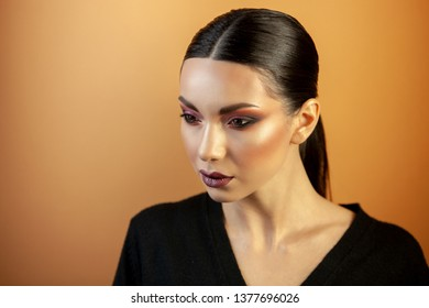 fashion portrait of an Asian type girl with burgundy eye shadows