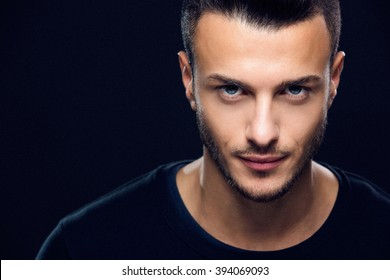 Fashion portrait of an attractive young man in the studio, close up. Beauty concept. Toned photo.
