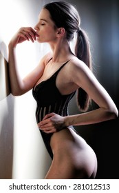Fashion portrait of beautiful brunette woman. Sexy young woman in sexy black lingerie.