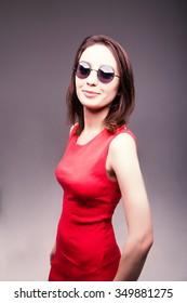Fashion portrait of a beautiful brunette woman in glasses