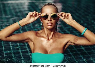 fashion portrait of beautiful chic woman in water