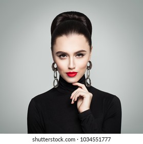 Fashion Portrait of Beautiful Elegant Woman in Black Roll Neck Jumper. Hair is Hair Bun  Hairstyle. Stylish Girl with Perfect Hairdo and Make up.