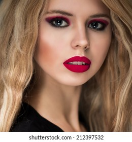 Fashion portrait of beautiful girl with red lips and blonde hair