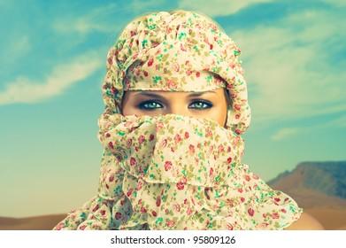 Fashion portrait of beautiful lady in Bedouin scarf