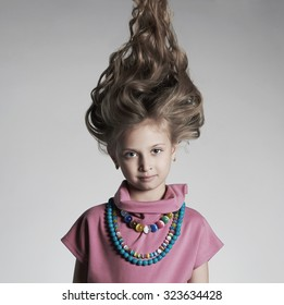 fashion portrait of beautiful little girl with healthy hair.pretty little lady in dress and accessories