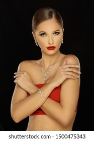 Fashion Portrait Of Beautiful Luxury Woman With Jewelry on black background