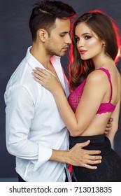 Fashion  portrait of a beautiful sexy couple, man and woman brunette