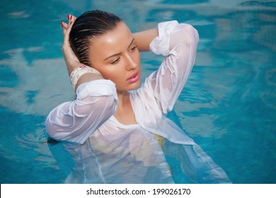 fashion portrait of beautiful and sexy women in pool