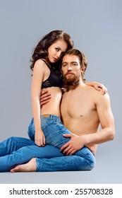 Fashion portrait of a beautiful tender lovers. Denim style.