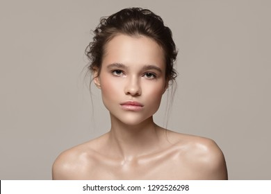 Fashion portrait of beautiful woman. Clear natural skin.