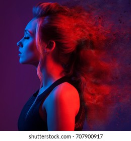 Fashion portrait of beautiful  woman. Explosion Hairstyle. Blue and red light.