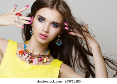 fashion portrait of beautiful woman with long hair and jewelry