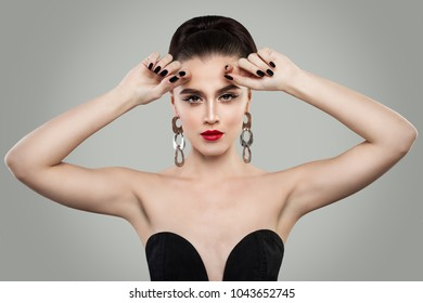Fashion Portrait of Beautiful Woman with Red Lips Makeup, Perfect Hairstyle and Manicure. Black Nail polish