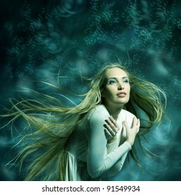 Fashion portrait of beautiful woman with streaming hair in cyan-green tones posing on bright illustrated background like mermaid