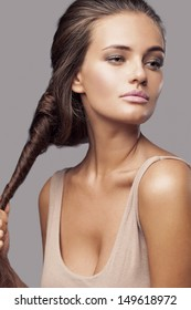 Fashion portrait of beautiful young girl making hairstyle / preparing for night club party