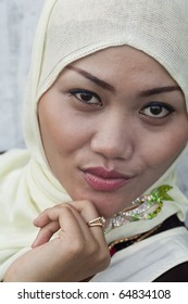 A Fashion Portrait of a Beautiful young Indonesian Muslim Woman in Sumatra!