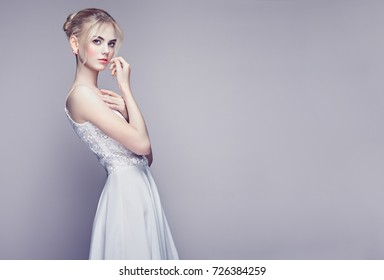 b8a51054f824 Fashion portrait of Beautiful Young Woman with Blonde Hair. Girl in white Dress  on White