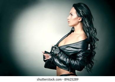 Fashion portrait of beautiful young woman looking away