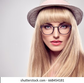 Fashion Portrait Beauty Sensual Blond Girl in Stylish glasses, Summer Outfit. Blue Eyes. Shiny Bang Hairstyle. Glamour Model Woman, Trendy Hat.
