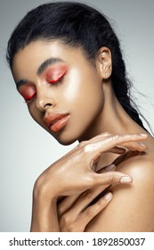 Fashion portrait of a black girl. Studio shooting. Bright makeup
