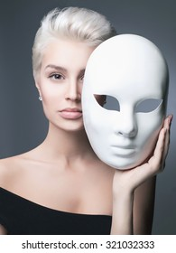 fashion portrait of blond lady with mask. beautiful girl at the carnival