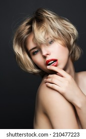 Fashion portrait of blonde girl with red lips