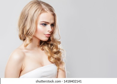 Fashion portrait of blonde woman with long hair and makeup