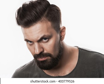 fashion portrait of a brutal bearded man.isolated handsome hipster man with beard