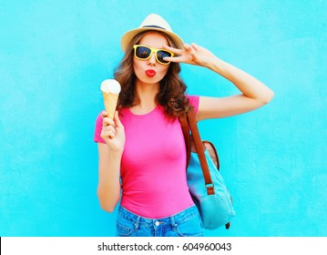 Fashion portrait cool young woman with ice cream over colorful blue background