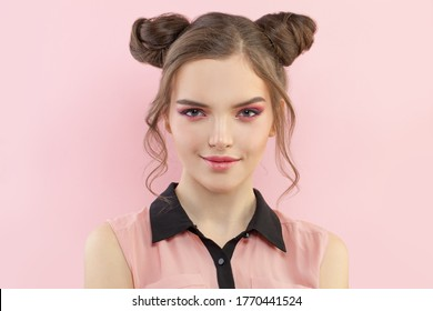 Fashion portrait of cute woman with pink eyeshadow makeup on pastel pink background