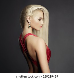 Fashion portrait of elegant blond woman in red dress