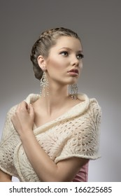 fashion portrait of elegant pretty girl with brown creative hair-style, precious earrings in emotional pose