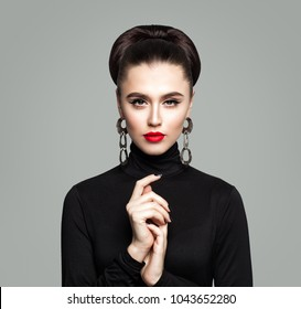 Fashion Portrait of Elegant Woman. Girl with Makeup, Manicure and Hair Updo. Cute Model in Black Clothes