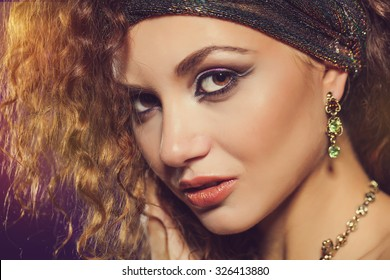 Fashion portrait of elegant woman with magnificent hair. Perfect make-up