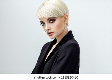 Fashion portrait of female model in short hair