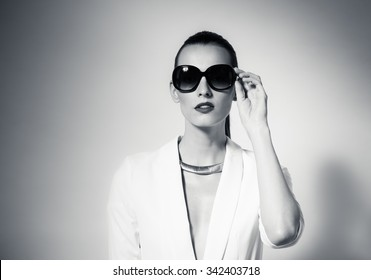 Fashion portrait of female wearing sunglasses.